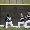 San Diego Padres pitchers including Ian Kennedy (22) stretch during conditioning drills at spring training baseball practice, Sunday, Feb. 16, 2014, in Peoria, Ariz The Associated Press