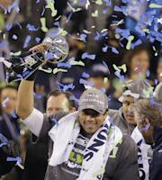 Seattle Seahawks quarterback Russell Wilson (3) holds up the Lombardi Trophy after winning the NFL Super Bowl XLVIII football game against the Denver Broncos, Sunday, Feb. 2, 2014, in East Rutherford, N.J. The Seahawks won 43-8. (AP Photo/Chris O'Meara)