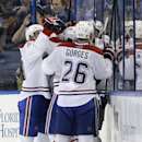 Montreal Canadiens right wing Dale Weise (22) is surrounded by teammates, including Josh Gorges (26), after scoring against the Tampa Bay Lightning during overtime of Game 1 of a first-round NHL hockey playoff series on Wednesday, April 16, 2014, in Tamp