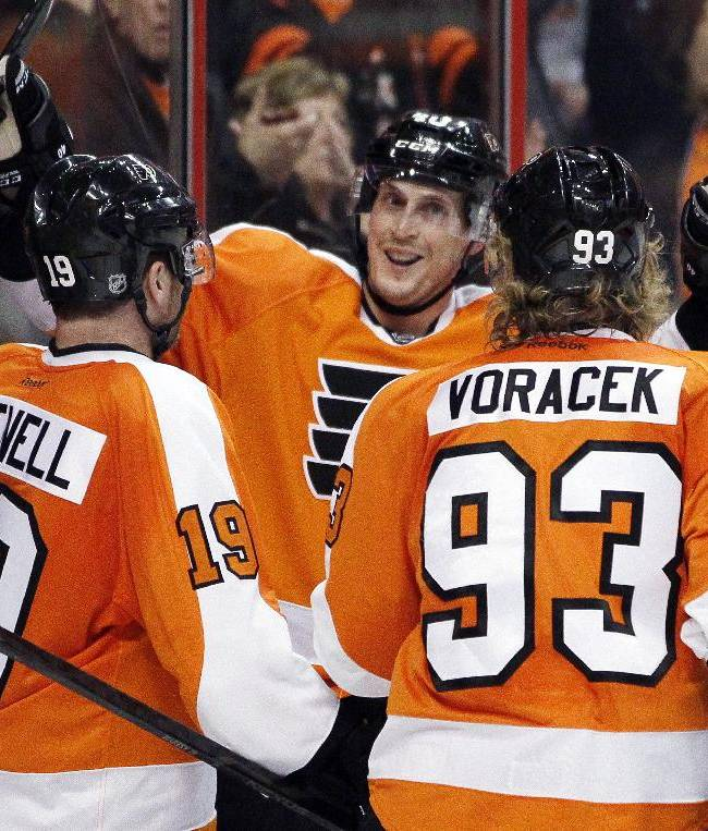 Philadelphia Flyers' Scott Hartnell, Vincent Lecavalier and Jakub Voracek, from left, celebrate Lecavalier's goal during the second period of an NHL hockey game against the Buffalo Sabres, Sunday, April 6, 2014, in Philadelphia. The Flyers won 5-2