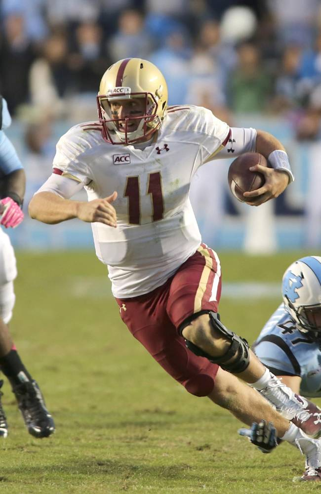 Boston College quarterback Chase Rettig carries the ball against North Carolina in the second half of an NCAA college football game in Chapel Hill, N.C., Saturday, Oct. 26, 2013. North Carolina won 34-10