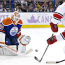 Carolina Hurricanes' Riley Nash (20) is stopped by Edmonton Oilers goalie Ben Scrivens (30) during the first period of an NHL hockey game Friday, Oct. 24, 2014, in Edmonton, Alberta The Associated Press