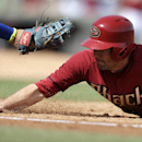Arizona Diamondbacks' A.J. Pollock, right, gets back safely to first base as Kansas City Royals first baseman Eric Hosmer reaches with his glove during the third inning of an exhibition spring training baseball game Wednesday, March 5, 2014, in Scottsdale