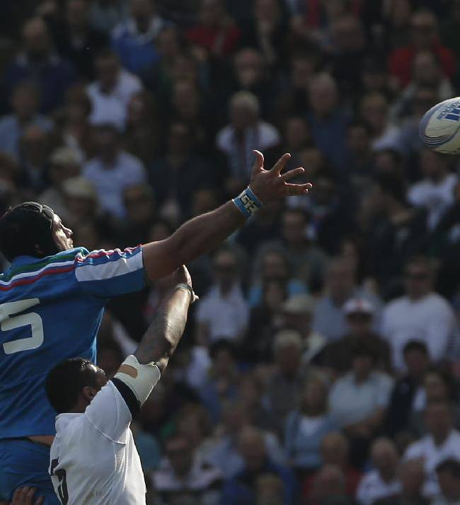 Italy's Marco Bortolami, left, and England's Courtney Lawes reach for the ball during a Six Nations international rugby union match between Italy and England, in Rome, Saturday, March 15, 2014. England won 52-11
