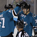 Couture scores 2 as Sharks beat Ducks 6-4 The Associated Press
