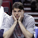 Atlanta Hawks guard Kyle Korver sits on the bench during the final moments of an NBA basketball game against the Portland Trail Blazers in Portland, Ore., Wednesday, March 5, 2014. Korver's NBA-record streak of 127 games with a 3-pointer came to an end
