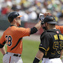 Baltimore Orioles' Steve Pearce, left, receives a high-five at the plate in front of Pittsburgh Pirates catcher Russell Martin, after hitting a two-run homerun during the fourth inning of a spring exhibition baseball game in Bradenton, Fla., Monday, March