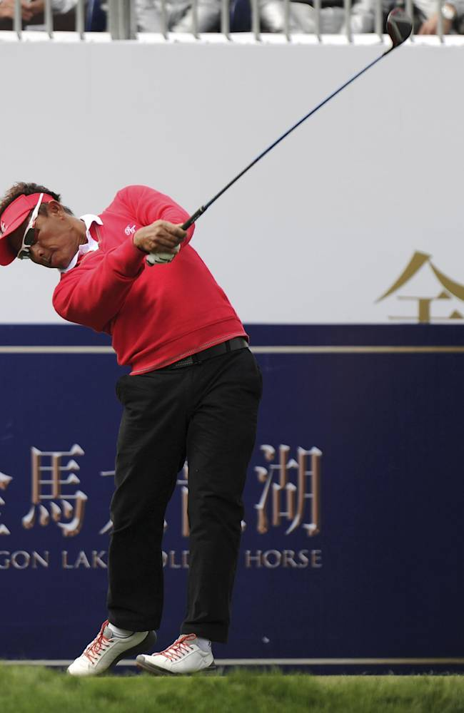 Thongchai Jaidee of Thailand tees off on the first hole during the Foursomes Match between Asian team's Thongchai and Kiradech Aphibarnrat of Thailand and European team's Stephen Gallacher and Paul Lawrie of Scotland at the 7th Edition of the Royal Trophy-Europe vs. Asia Golf Championship at Dragon Lake Golf Club in Guangzhou, in south China's Guangdong province, Friday, Dec. 20, 2013