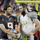 Dallas Cowboys' Tony Romo talks to Indianapolis Colts' Andrew Luck before the NFL Football Pro Bowl Sunday, Jan. 25, 2015, in Glendale, Ariz The Associated Press