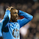 Tottenham Hotspur's Jermain Defoe reacts during their English Premier League soccer match against Fulham, at the Craven Cottage stadium in London, Wednesday, Dec. 4, 2013