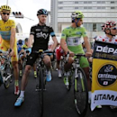 Astana team rider and Tour de France winner Vincenzo Nibali (L) of Italy waits for the start of the race next to Team Sky rider Christopher Froome (2nd L) of Britain, Cannondale team rider Peter Sagan of Slovakia (2nd R), and Tinkoff-Saxo team rider Ral Majka (R) of Poland before the Tour de France Saitama Criterium race in Saitama, north of Tokyo October 25, 2014. REUTERS/Yuya Shino