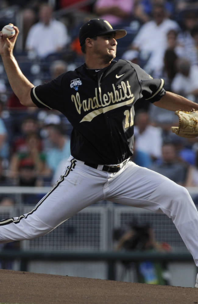 Vanderbilt's Tyler Beede pitches in the inning of Game 2 of the best-of-three NCAA baseball College World Series finals against Virginia in Omaha, Neb., Tuesday, June 24, 2014