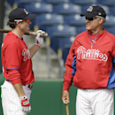 Philadelphia Phillies manager Ryne Sandberg, right, talks with second baseman Chase Utley before an exhibition baseball game against the Atlanta Braves Wednesday, March 5, 2014, in Clearwater, Fla The Associated Press