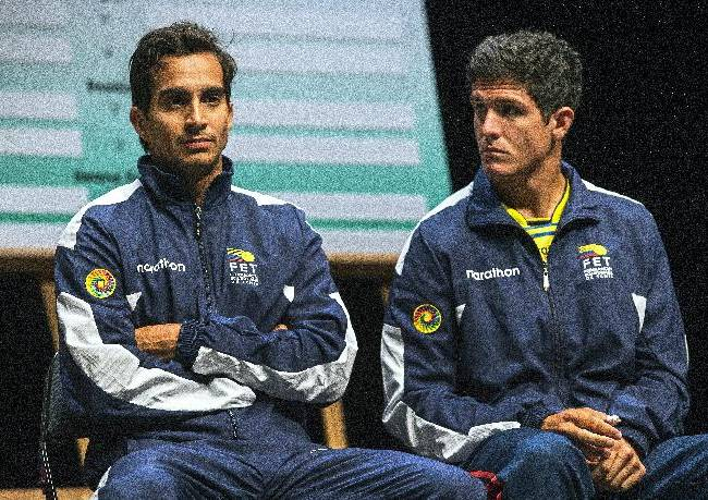 Ecuador's Davis Cup players Julio-Cesar Campozano, left, and Emilio Gomez, right, listen to a speech during the drawing for the tennis Davis Cup World Group Play-off round match between Switzerland and Ecuador, in Neuchatel, Switzerland, Thursday, Sept. 12, 2013. Switzerland will play against Ecuador for the Davis Cup World Group Play-off round matches starting on Sept. 13 in Neuchatel