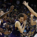 Golden State Warriors' Harrison Barnes, left, and Klay Thompson, right, guard Phoenix Suns' Goran Dragic during the second half of an NBA basketball game Sunday, March 9, 2014, in Oakland, Calif The Associated Press