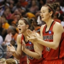 Louisville forwards Sara Hammond, left, and Cortnee Walton cheer from the bench in the first half of the Oklahoma City regional final against Tennessee in the NCAA women's college basketball tournament in Oklahoma City, Tuesday, April 2, 2013. (AP Photo/Sue Ogrocki)