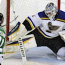 St. Louis Blues goalie Brian Elliott (1) deflects a shot against Dallas Stars center Tyler Seguin (91) during the third period of an NHL hockey game, Tuesday, Oct. 28, 2014, in Dallas The Associated Press