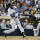 Detroit Tigers' Austin Jackson swings on a bases-loaded double in the ninth inning of a baseball game against the San Diego Padres Saturday, April 12, 2014, in San Diego. The Padres had intentionally walked Miguel Cabrera to pitch to Jackson. Two runs sco