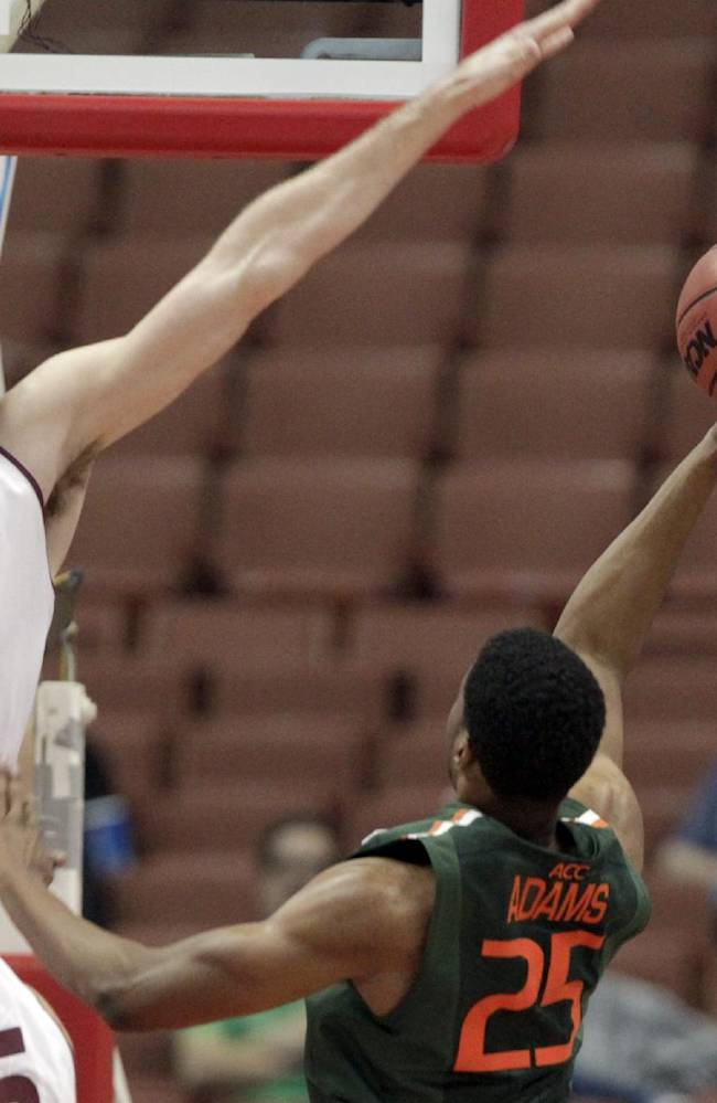Arizona State center Jordan Bachynski (13) defends as Miami guard Garrius Adams (25) shoots in the first half of an NCAA men's college basketball game at the Wooden Legacy tournament in Anaheim, Calif., Sunday, Dec. 1, 2013