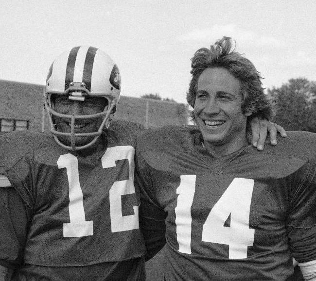 FILE- This Sept. 22, 1976 file photo shows New York Jets quarterback Joe Namath, left, posing with then Jets draft choice Richard Todd, also a quarterback, during a break in training at the Jets camp in Hempstead, New York. Todd led the Jets to the playoffs only twice in his eight seasons