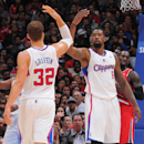LOS ANGELES, CA - APRIL 16: Blake Griffin #32 and DeAndre Jordan #6 of the Los Angeles Clippers high-five during a game against the Portland Trail Blazers at Staples Center on April 16, 2013 in Los Angeles, California. (Photo by Andrew D. Bernstein/NBAE via Getty Images)