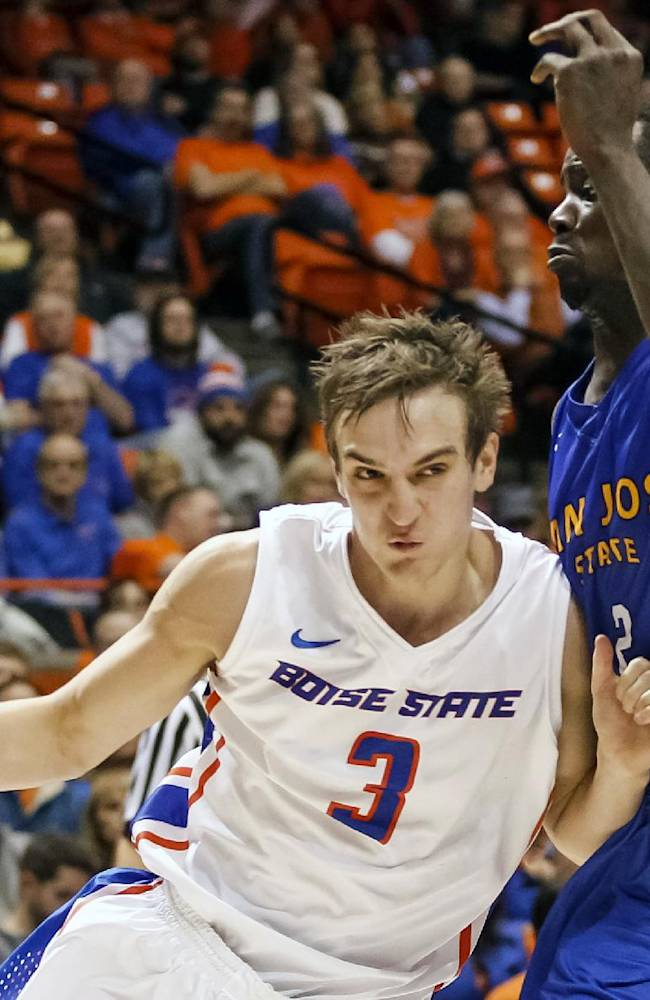 Boise State's Anthony Drmic (3) drives the ball against San Jose State's Jaleel Williams (2) during the second half of an NCAA college basketball game in Boise, Idaho, on Saturday, Jan. 25, 2014. Boise State won 76-55