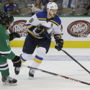 St. Louis Blues center Steve Ott (9) skates with the puck against Dallas Stars Curtis McKenzie (11) during the first period of an NHL pre-season hockey game, Monday, Sept. 22, 2014, in Dallas The Associated Press