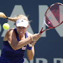 Angelique Kerber, of Germany, returns the ball during the second set of her match against Coco Vandeweghe in the Bank of the West Classic tennis tournament, Thursday, July 31, 2014, in Stanford, Calif. (AP Photo/Beck Diefenbach)