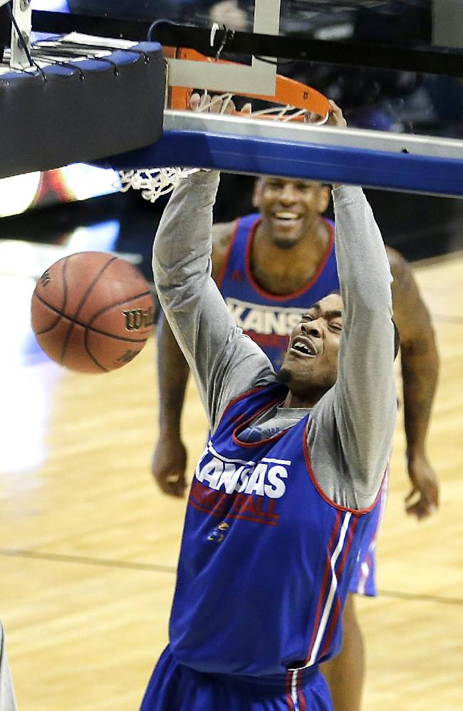 Kansas' Frank Mason dunks the ball during practice for the NCAA college basketball tournament Thursday, March 20, 2014, in St. Louis. Kansas is scheduled to play against Eastern Kentucky in a second-round game on Friday