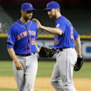 New York Mets' Ike Davis, right, slaps teammate Carlos Torres on the shoulder in celebration after the final out in the ninth inning of a baseball game against the Arizona Diamondbacks on Monday, April 14, 2014, in Phoenix. The Mets defeated the Diamondb