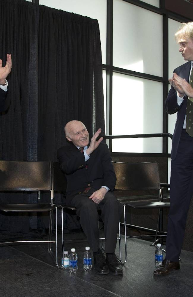 New York investment firm executives Marc Lasry, right, and Wesley Edens, left, applaud as Milwaukee Bucks owner Herb Kohl waves during a news conference after reaching a deal to sell the franchise, Wednesday, April 16, 2014, in Milwaukee