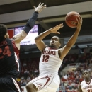 Alabama guard Trevor Releford (12) drives to the basket against Stanford during the first half of an NCAA basketball game in the second round of the NIT on Saturday March 23, 2013 at Coleman Coliseum in Tuscaloosa, Ala. (AP Photo/The Tuscaloosa News, Robert Sutton)
