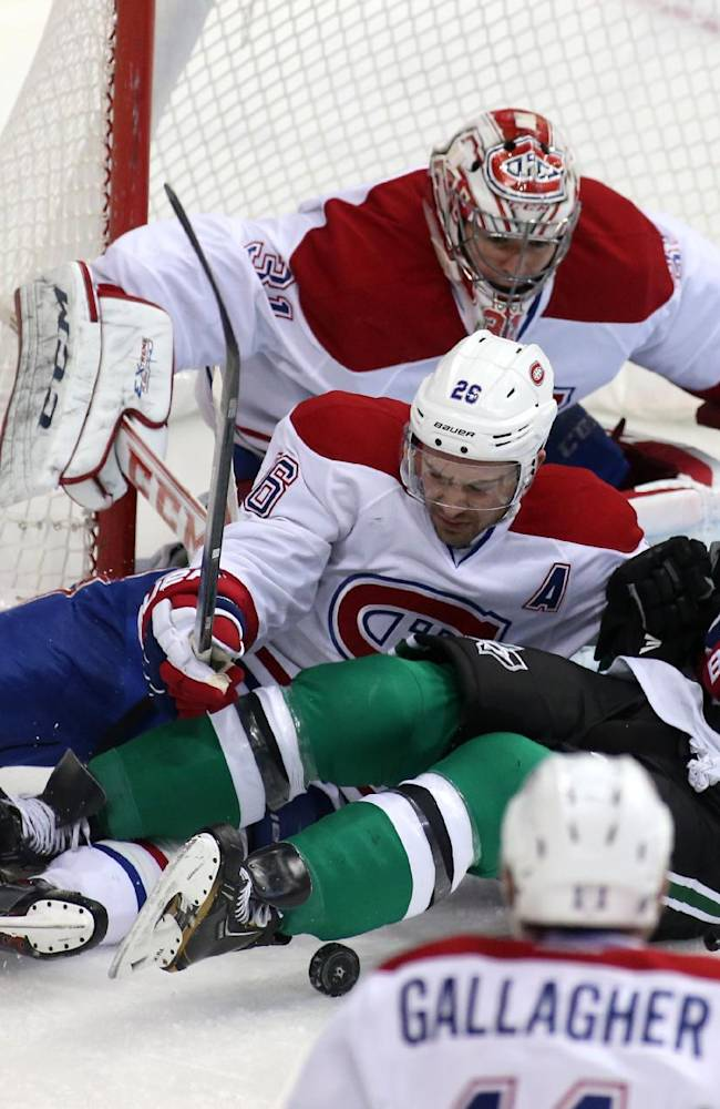 Montreal Canadiens goalie Carey Price (31), defenseman Josh Gorges (26) and right wing Brendan Gallagher (11) keep Dallas Stars defenseman Aaron Rome (27) away from the goal during the third period of an NHL hockey game Thursday, Jan. 2, 2014, in Dallas. Montreal won 6-4