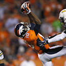 Denver Broncos wide receiver Emmanuel Sanders (10) makes a catch as San Diego Chargers' Eric Weddle, left, and Jason Verrett defend during the first half of an NFL football game, Thursday, Oct. 23, 2014, in Denver The Associated Press
