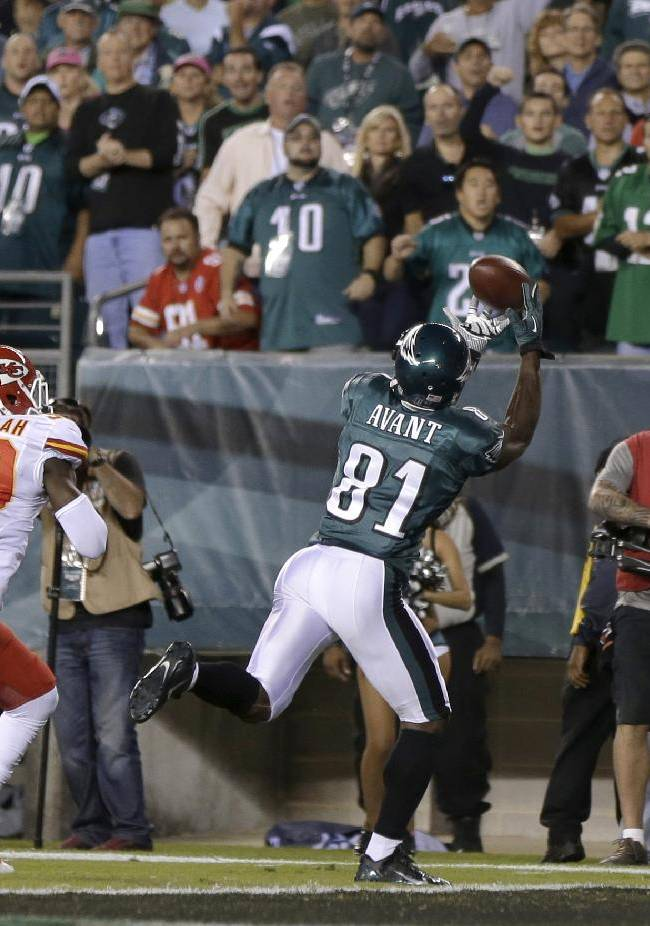 Philadelphia Eagles' Jason Avant, right, pulls in a touchdown pass as Kansas City Chiefs' Husain Abdullah defends during the first half of an NFL football game, Thursday, Sept. 19, 2013, in Philadelphia