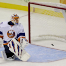 A shot by New Jersey Devils' Travis Zajac goes in past New York Islanders goalie Jaroslav Halak (41), of Slovakia, for the only goal of the shootout in a preseason NHL hockey game, Thursday, Oct. 2, 2014, in Newark, N.J. The Devils won 2-1 The Associated