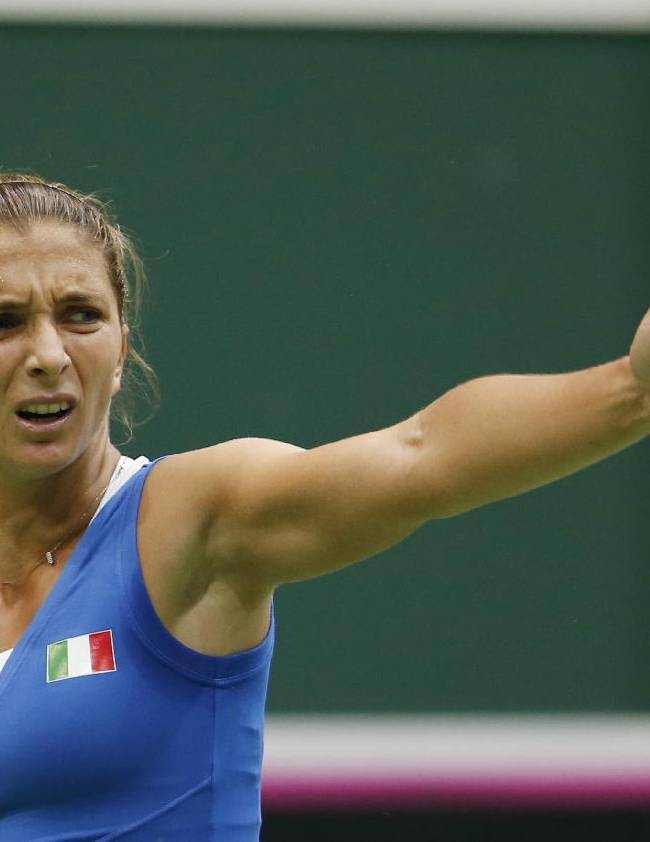 Italy's Sara Errani reacts during the tennis Fed Cup semifinals against Czech Republic's Lucie Safarova in Ostrava, Czech Republic, Saturday, April 19, 2014