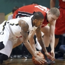 Oregon's Carlos Emory, left, and Utah's Xan Ricketts reach for a loose ball during the first half of an NCAA college basketball game in Eugene, Ore., Saturday Feb. 9, 2013. (AP Photo/Chris Pietsch)