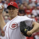Cincinnati Reds starting pitcher Homer Bailey throws against the Chicago Cubs in the first inning of the MLB National League baseball game, Saturday, May 25, 2013, in Cincinnati. (AP Photo/Al Behrman)