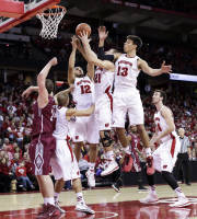 Wisconsin's Ben Brust, second from left, Traevon Jackson (12), Josh Gasser (21), and Duje Dukan (13) go after a defensive rebound against Eastern Kentucky's Jeff Johnson, left, during the first half of an NCAA college basketball game Saturday, Dec. 14, 2013, in Madison, Wis. (AP Photo/Andy Manis)
