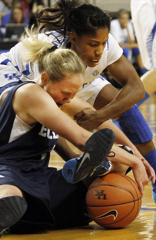 Kentucky's Janee Thompson and Eckerd's Sarah Ammons go after a loose ball during the first half of an NCAA college basketball exhibition game, Sunday, Nov. 3, 2013, in Lexington, Ky