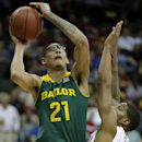 Baylor's Isaiah Austin (21) shoots under pressure from Oklahoma's Cameron Clark, right, during the second half of an NCAA college basketball game in the Big 12 men's tournament on Thursday, March 13, 2014, in Kansas City, Mo. (AP Photo/Charlie Riedel)