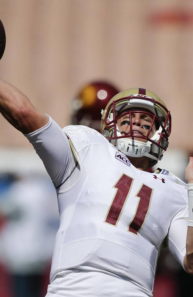 Boston College quarterback Chase Rettig throws during warms ups for an NCAA college football game against Southern California in Los Angeles, Saturday, Sept. 14, 2013