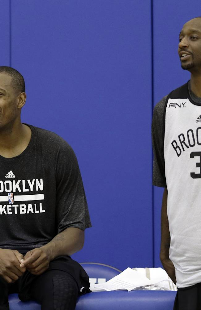 Brooklyn Nets' Paul Pierce, left, and Jason Terry watch during a break in action at NBA basketball training camp at Duke University in Durham, N.C., Wednesday, Oct. 2, 2013
