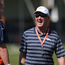 Denver Broncos head coach John Fox, right, jokes with starting quarterback Peyton Manning during a morning session at the team's NFL football training camp in Englewood, Colo., on Friday, July 25, 2014. (AP Photo) The Associated Press