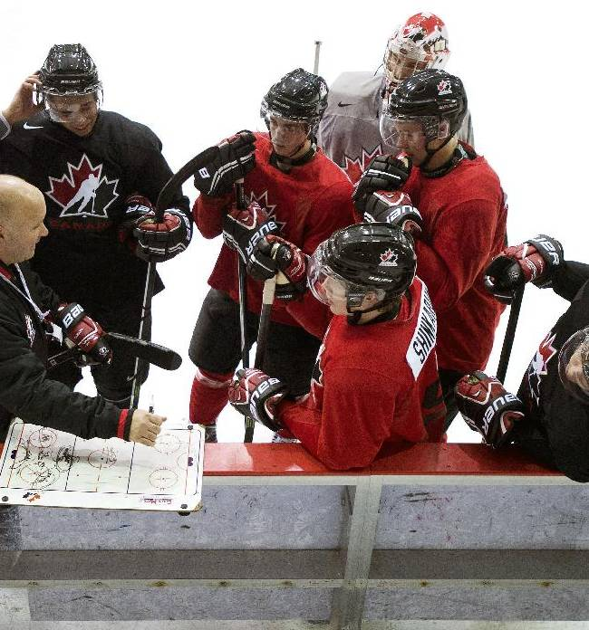 Team Canada players get a drill explained to them during the world juniors selection camp in Toronto on Friday, Dec. 13, 2013