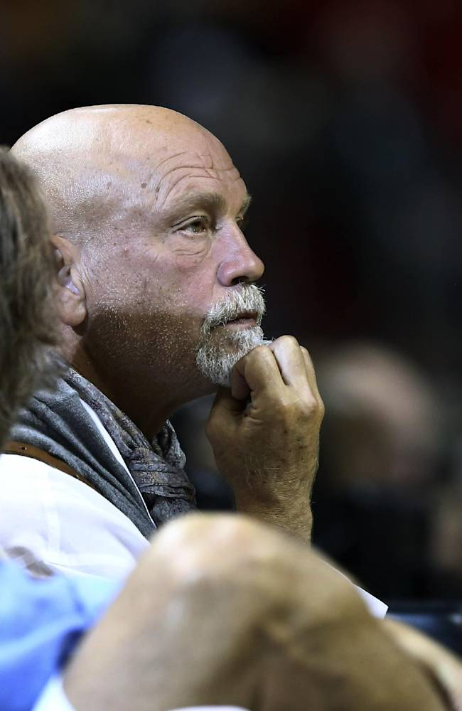 Actor John Malkovich watches game action during the first half of a NBA basketball game between the San Antonio Spurs and Miami Heat in Miami, Sunday, Jan. 26, 2014
