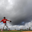St. Louis Cardinals' Tony Cruz, left, plays catch with teammate Yadier Molina as they warm up at the start of spring training baseball practice Friday, Feb. 21, 2014, in Jupiter, Fla The Associated Press