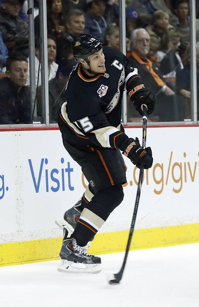Anaheim Ducks center Ryan Getzlaf passes the puck against the Florida Panthers during the first period of an NHL hockey game on Sunday, March 23, 2014 in Anaheim, Calif. The Ducks won 6-2