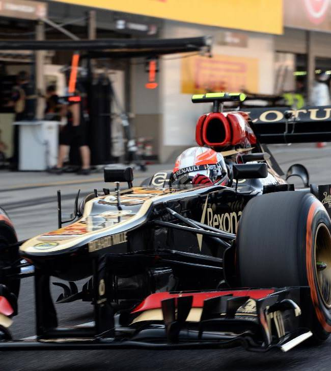 Lotus driver Romain Grosjean of France leaves his pit  during the qualifying session for the Japanese Formula One Grand Prix at the Suzuka circuit in Suzuka, Japan, Saturday, Oct. 12, 2013